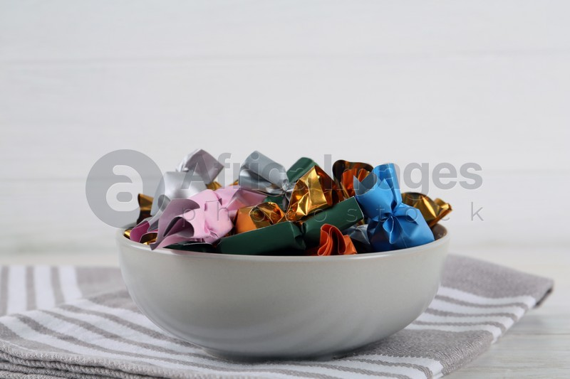Candies in colorful wrappers on white table