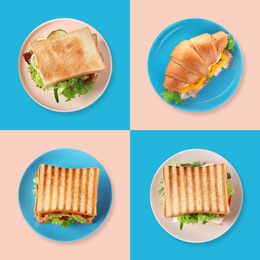 Set of yummy sandwiches and croissant on color background, top view