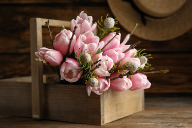 Beautiful bouquet of spring pink tulips on wooden table