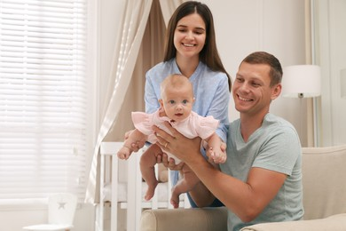 Happy family with their cute baby at home