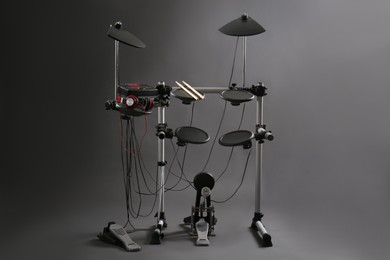 Modern electronic drum kit on grey background. Musical instrument