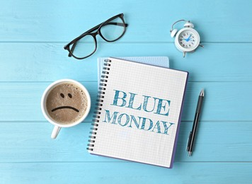 Blue Monday. Flat lay composition with office stationery and cup of coffee on wooden table