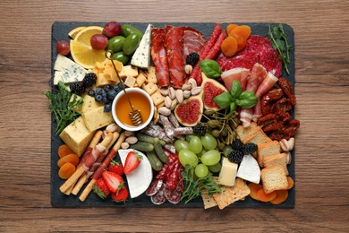 Set of different delicious appetizers served on wooden table, top view
