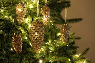 Christmas tree decorated with holiday baubles and fairy lights, closeup
