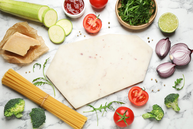 Flat lay composition with fresh products on marble table, space for text. Healthy cooking