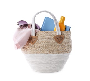 Bag with different beach objects on white background