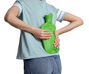 Woman using hot water bottle to relieve back pain isolated on white, closeup