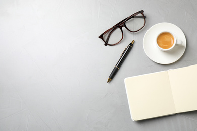 Flat lay composition with coffee on grey table, space for text. Tasty breakfast