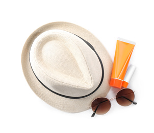 Sun protection products, sunglasses and hat on white background, top view. Beach objects