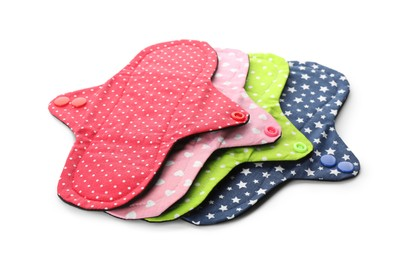 Many cloth menstrual pads on white background. Reusable female hygiene product