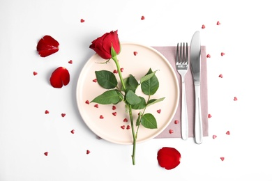 Beautiful table setting for romantic dinner on white background, flat lay. Valentine's day celebration