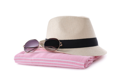 Towel, sunglasses and hat on white background. Beach objects