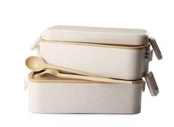 Eco friendly lunch boxes with cutlery on white background. Conscious consumption