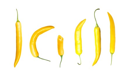 Set with ripe yellow chili peppers on white background