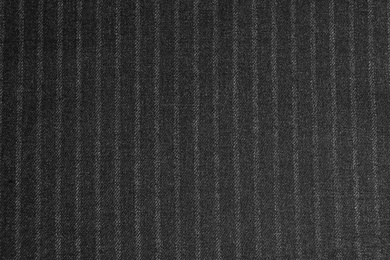Texture of dark striped fabric as background, closeup