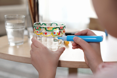 Little girl painting glass at table indoors, closeup. Creative hobby
