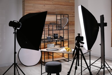 Professional equipment and many lemons on table in studio. Food photo