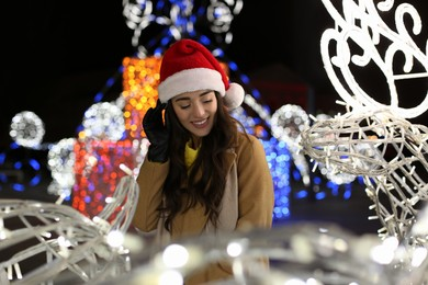 Young woman spending time at Christmas fair