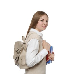 Teenage student with backpack and books on white background