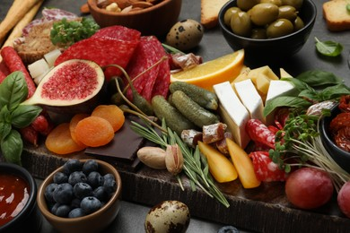 Set of different delicious appetizers served on grey table, closeup