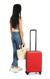 Woman with suitcase and bag for vacation trip on white background. Summer travelling