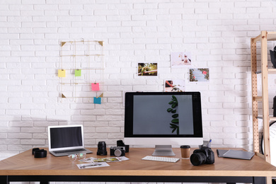 Photographer's workplace with professional camera in office