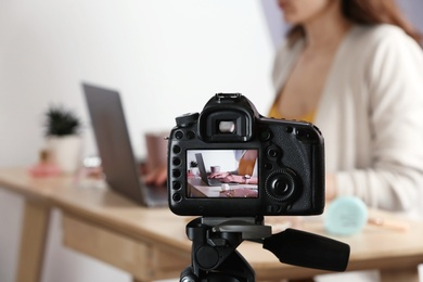 Photo of blogger at workplace on camera screen, closeup with space for text