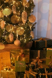 Many different gifts under Christmas tree indoors