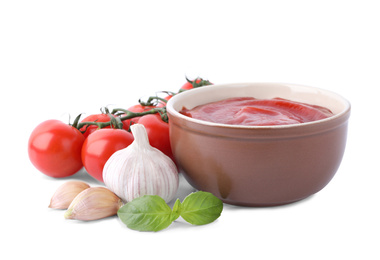 Delicious tomato sauce and ingredients on white background