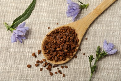 Spoon of chicory granules and flowers on sackcloth, flat lay
