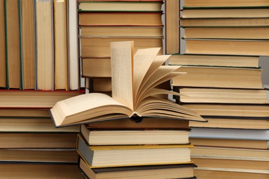 Many hardcover books as background. Library material