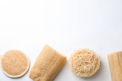 Natural shower loofah sponges on white background, top view