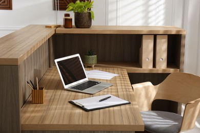 Receptionist's workplace with laptop in hotel. Interior design
