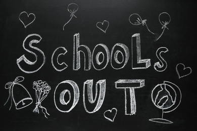 Text SCHOOL'S OUT and different drawings on blackboard. Summer holidays