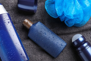Flat lay composition with men's cosmetics on grey towel