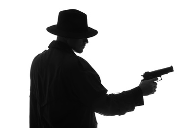 Old fashioned detective with gun on white background