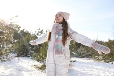 Cute little girl outdoors on winter day. Christmas vacation