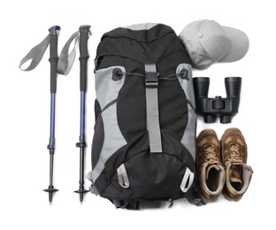 Pair of trekking poles and camping equipment for tourism on white background, top view