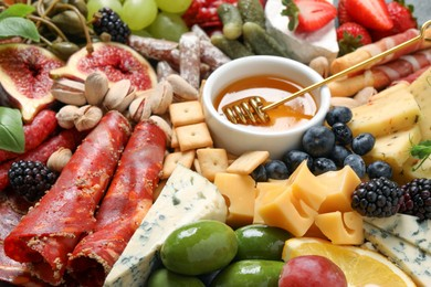 Set of different delicious appetizers as background, closeup