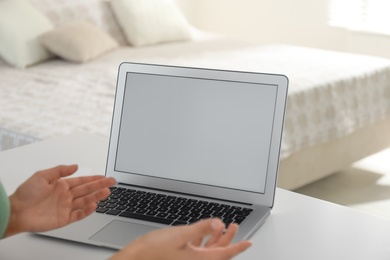Coworkers working together online. Young woman using video chat on laptop, closeup