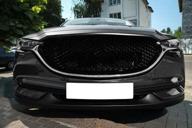 Car with vehicle registration plate outdoors. Mockup for design