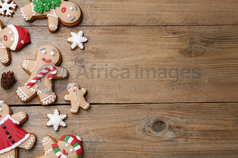 Delicious Christmas cookies on wooden table, flat lay. Space for text