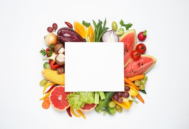 Fresh organic fruits, vegetables and blank card on white background, flat lay. Space for text