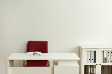Stylish workplace interior with modern office chair and desk