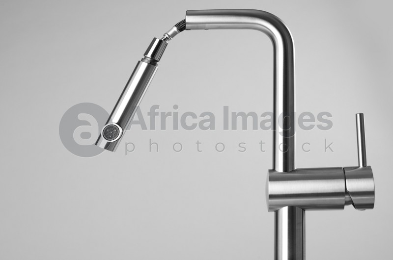 Modern pull out kitchen faucet on grey background