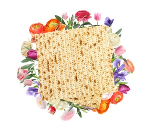 Tasty matzo and flowers on white background, top view. Passover (Pesach) celebration