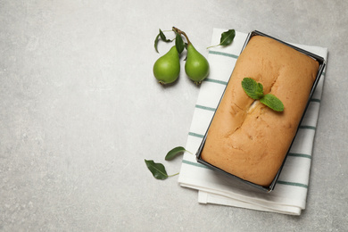 Tasty bread and pears on light grey table, flat lay   with space for text. Homemade cake