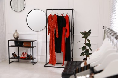Collection of trendy women's garments in clothing rental salon