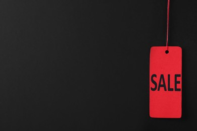 Sale red tag on color background, space for text. Black Friday