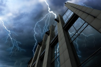 Dark cloudy sky with lightning over building. Stormy weather